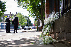 © Licensed to London News Pictures. 12/07/2020. London, UK. Flowers and candles have been placed next to a Police cordon on the Black Prince Estate. Police were called shortly after 2200hrs on Saturday, 11 July, to a man stabbed on the Black Prince Estate in Kennington. Officers attended along with London Ambulance Service and found a 30-year-old man suffering stab injuries. Despite the efforts of officers and paramedics, the man was pronounced dead at the scene. Photo credit: George Cracknell Wright/LNP