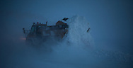 A Cruz Construction Inc. ejector truck dumps ice chips near the end of the 27 mile long Prudhoe Bay - Badami ice road on Januray 24, 2013. The road to Badami is part of a longer winter-only corridor to the Point Thompson field.