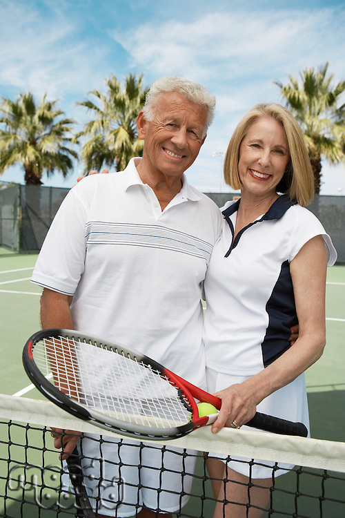 Happy Couple on the Tennis Court