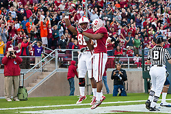 November 6, 2010; Stanford, CA, USA;  Stanford Cardinal wide receiver Chris Owusu (81) celebrates with wide receiver Doug Baldwin (89) after scoring a touchdown against the Arizona Wildcats during the first quarter at Stanford Stadium.