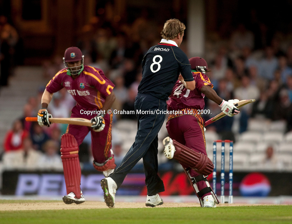 Bowler Stuart Broad pushes Dwayne Bravo during a quick single in the ICC World Twenty20 Cup match between West Indies and England at The Oval. Photo © Graham Morris (Tel: +44(0)20 8969 4192 Email: sales@cricketpix.com)