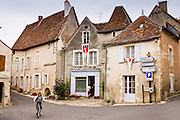 Cyclist in traditional French village of Angles Sur L'Anglin, Vienne, near Poitiers, France