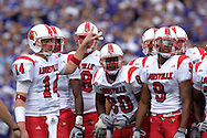 Louisville quarterback Hunter Cantwell (14) looks for a play form the sideline against Kansas State at Bill Snyder Family Stadium in Manhattan, Kansas, September 23, 2006.  The 8th ranked Louisville Cardinals beat K-State 24-6.