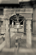 A temple bell and a shaivite (follower of Shiva) at Pashupatinath in Kathmandu.