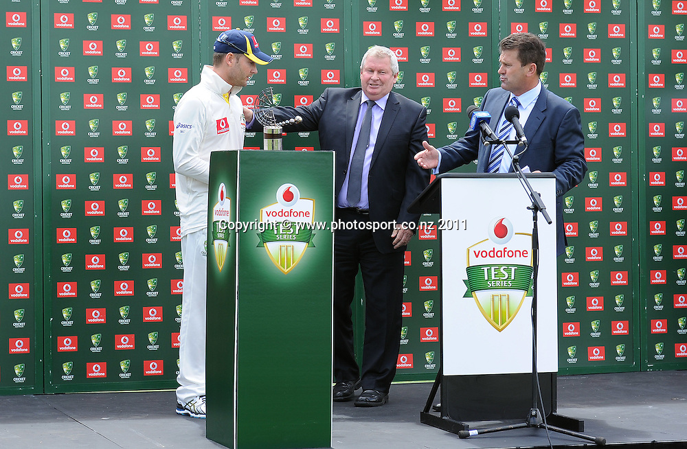 Australian captain Michael Clarke accepts the Trans Tasman trophy from Ian Smith and Mark Taylor on Day 4 of the second cricket test between Australia and New Zealand Black Caps at Bellerive Oval in Hobart, Monday 12 December 2011. Photo: Andrew Cornaga/Photosport.co.nz