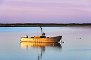 Small motorboat at sunrise, Crackatuxet Cove, South Beach, Martha's Vineyard, Massachusetts, USA