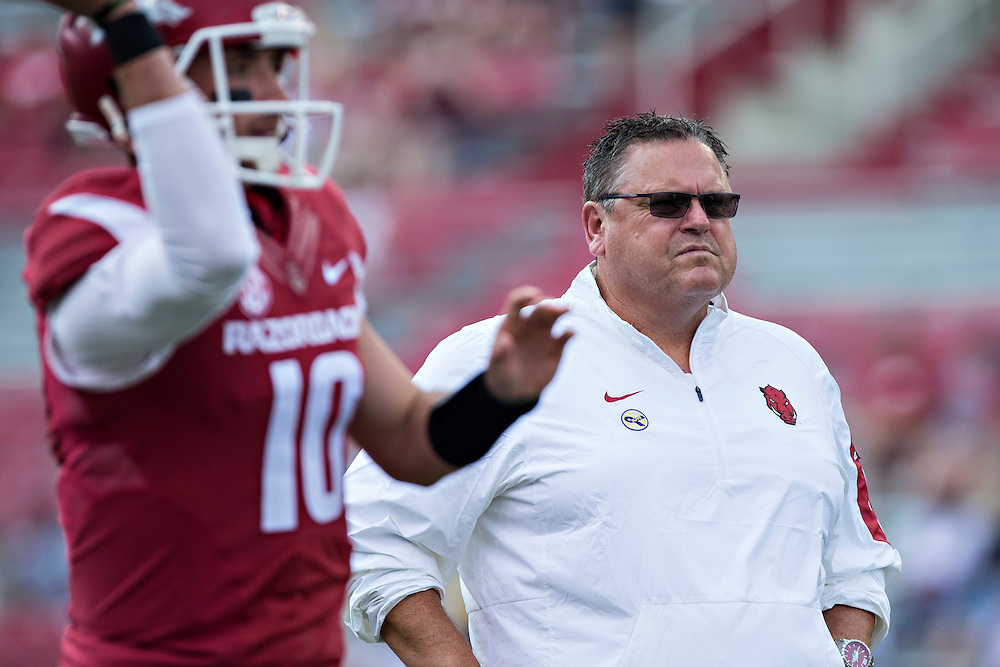 FAYETTEVILLE, AR - SEPTEMBER 5:  Offensive line coach Sam Pittman of the Arkansas Razorbacks watches the team warm up before a game against the UTEP Miners at Razorback Stadium on September 5, 2015 in Fayetteville, Arkansas.  The Razorbacks defeated the Miners 48-13.  (Photo by Wesley Hitt/Getty Images) *** Local Caption *** Sam Pittman