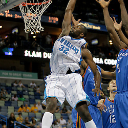 Oct 10, 2009; New Orleans, LA, USA;  New Orleans Hornets forward Julian Wright (32) attempts a dunk past Oklahoma City Thunder defenders during the second quarter at the New Orleans Arena. Mandatory Credit: Derick E. Hingle-US PRESSWIRE