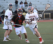DOYLESTOWN, PA - APRIL 16:  Central Bucks East's Logan Nelson #28 charges the net as Hatboro Horsham's Nick Paci #19 defends in the first period at War Memorial Field April 16, 2014 in Doylestown, Pennsylvania. (Photo by William Thomas Cain/Cain Images)