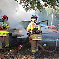 (Floyd Ingram / Buy at photos.chickasawjournal.com)<br /> Houston firefighters Mitchell Slaughter and Billy Watkins spray a car on fire in the parking lot of Trace Regional Hospital Friday morning Sept. 30, 2016. No one was hurt in the blaze and the cause of the fire has not been determined.