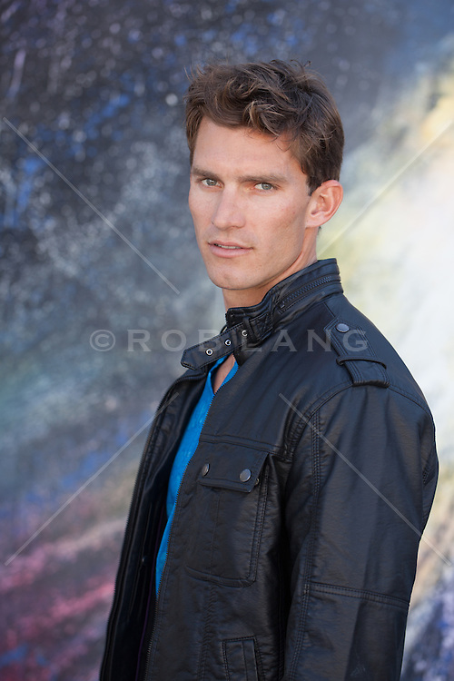 portrait of a handsome guy in a leather jacket