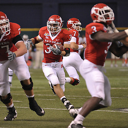 Dec 19, 2009; St. Petersburg, Fla., USA; Rutgers running back Joe Martinek (38) looks for a running lane during NCAA Football action in Rutgers' 45-24 victory over Central Florida in the St. Petersburg Bowl at Tropicana Field.