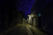 View down Brewer Street towards St Aldates next to old city walls at night