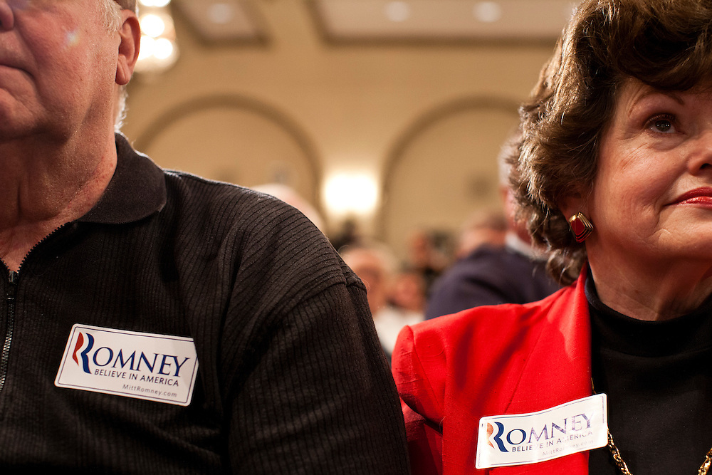People listen as Republican presidential candidate Mitt Romney holds a campaign rally on Tuesday, December 27, 2011 in Davenport, IA.