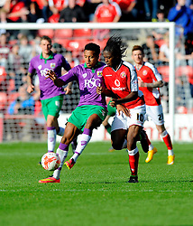 Bristol City's Korey Smith battles for the ball with Walsall's Romaine Sawyers  - Photo mandatory by-line: Joe Meredith/JMP - Mobile: 07966 386802 - 04/10/2014 - SPORT - Football - Walsall - Bescot Stadium - Walsall v Bristol City - Sky Bet League One