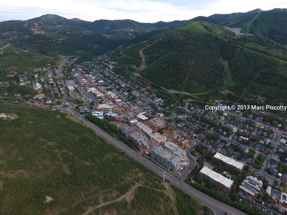 SHOT 7/1/17 9:07:09 PM - Drone photos of Park City, Utah. Park City lies east of Salt Lake City in the western state of Utah. Framed by the craggy Wasatch Range, it's bordered by the Deer Valley Resort and the huge Park City Mountain Resort, both known for their ski slopes. Utah Olympic Park, to the north, hosted the 2002 Winter Olympics and is now predominantly a training facility. In town, Main Street is lined with buildings built during a 19th-century silver mining boom. (Photo by Marc Piscotty / © 2017)