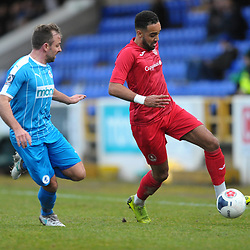 TELFORD COPYRIGHT MIKE SHERIDAN Brendon Daniels of Telford holds off Brad Jackson during the Vanarama Conference North fixture between AFC Telford United and Chester at the 1885 Arena Deva Stadium on Saturday, December 21, 2019.<br /> <br /> Picture credit: Mike Sheridan/Ultrapress<br /> <br /> MS201920-035