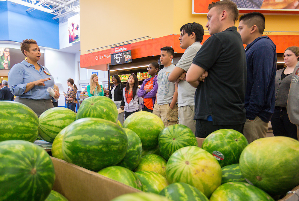 Scarborough High School students listen as Walmart store manager Tannika Scott talks about seasonal retail strategies, May 22, 2014.