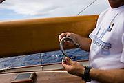 repairing a broken shakle onboard Signe