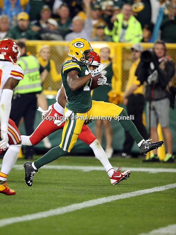 Green Bay Packers wide receiver Randall Cobb (18) races for the end zone as he catches a second quarter touchdown pass nullified by penalty during the 2015 NFL week 3 regular season football game against the Kansas City Chiefs on Monday, Sept. 28, 2015 in Green Bay, Wis. The Packers won the game 38-28. (©Paul Anthony Spinelli)