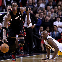 March 10, 2011; Miami, FL, USA; Miami Heat power forward Chris Bosh (1) drives past Los Angeles Lakers power forward Lamar Odom (7) during the fourth quarter at the American Airlines Arena. The Heat defeated the Lakers 94-88.   Mandatory Credit: Derick E. Hingle
