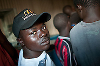 Morris Otien, a supporter of Raila Odinga's CORD Alliance , watches the election results in the Kibera slums of Nairobi, a Raila stronghold.
