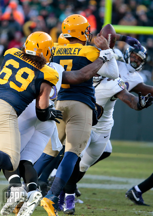 Green Bay Packers quarterback Brett Hundley (7) is sacked by Baltimore Ravens outside linebacker Terrell Suggs (55) and fumbled in the 4th quarter.  The Ravens recovered <br /> The Green Bay Packers hosted the Baltimore Ravens at Lambeau Field Sunday, Nov. 19, 2017. The Packers lost 23-0. STEVE APPS FOR THE STATE JOURNAL.
