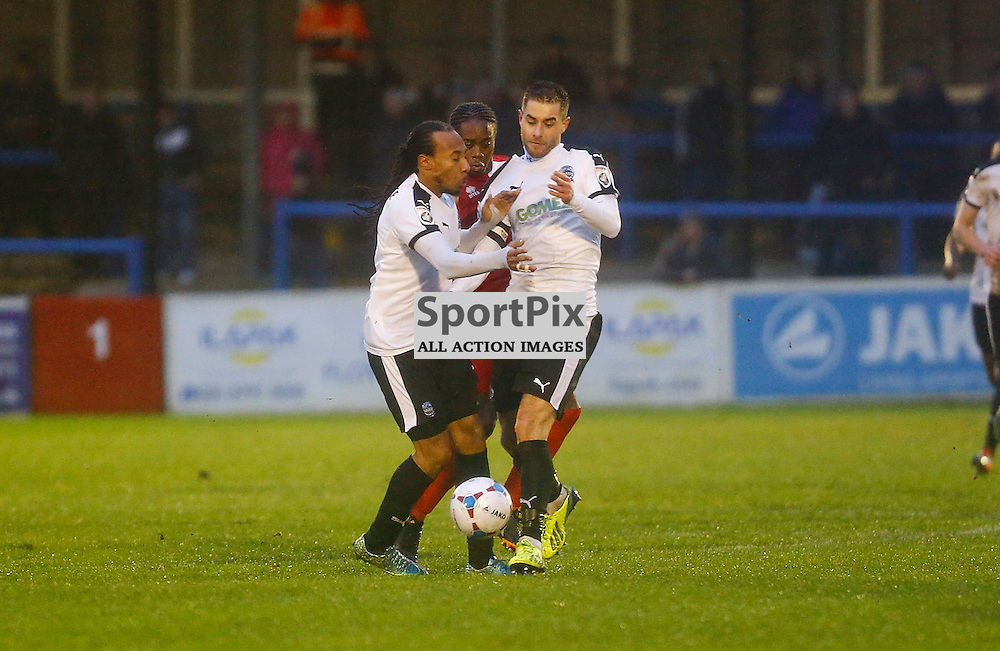 Dover's winger Ricky Modests (7) and Dover's midfielder Nick Deverdics (17) collide. The weather forced the game between Dover Athletic v Welling United to be abandoned shortly into the second half. Vanarama National League. 02  January 2016. (c) Matt Bristow | SportPix.org.uk
