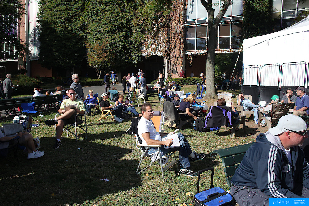 Race goers relax in the outside picnic area at Belmont Park during the Jockey Club Gold Cup Day, Belmont Park, New York. USA. 28th September 2013. Photo Tim Clayton