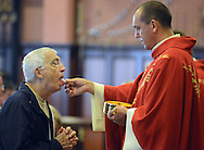 POPESHRINE20P<br /> Thomas Francis Lombardi (L), of Pineville, Pennsylvania receives holy communion from Father Rafal Walczyk during 11:30am mass at the National Shrine of Our Lady of Czestochowa Monday September 14, 2015 in Doylestown, Pennsylvania. Pope Francis will visit Philadelphia September 26 and 27th. (William Thomas Cain/For The Inquirer)