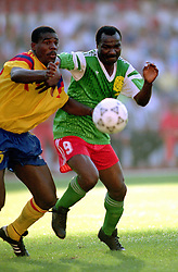 Roger Milla (right),Cameroon in action against Colombia