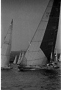 Round Ireland Yacht Race.  (R81)..1988..18.06.1988..06.18.1988..18th June 1988..The Round Ireland Yacht Race set sail from Wicklow today. Yachts from all over Europe took part in the start as the race got underway. The race is sponsored by Cork Dry Gin...Whyte and Mackay Drum K3797 is pictured under  full sail as the race gets underway at Wicklow today. She is seen passing Woodchester Challenge K150.