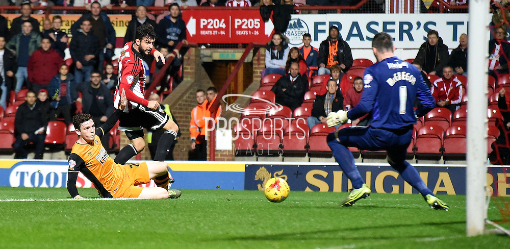 Marco Djuricin pulls a good save from Allan McGregor during the Sky Bet Championship match between Brentford and Hull City at Griffin Park, London, England on 3 November 2015. Photo by Michael Hulf.