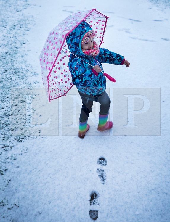 © Licensed to London News Pictures. 10/12/2017. Reading, UK. A toddler walks in the fresh snow near Reading, Berkshire, as parts of the south east of England are blanketed with snow for the first time this winter. Photo credit: Peter Macdiarmid/LNP
