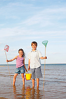 Girl and Boy Playing at Beach