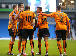 Jordan Graham ( 2nd  R ) of Wolverhampton Wanderers celebrates with team mates after his cross is turned in for an own goal by Connor Goldson ( not pictured ) of Brighton and Hove Albion to make it 1-0 - Mandatory byline: Paul Terry/JMP - 07966 386802 - 01/01/2016 - FOOTBALL - Falmer Stadium - Brighton, England - Brighton v Wolves - Sky Bet Championship