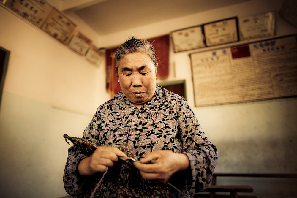 elderly chinese woman knitting