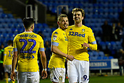 Kalvin Phillips (23) of Leeds United and Patrick Bamford (9) of Leeds United look up to the Leeds United fans at full time after a 3-0 win over Reading during the EFL Sky Bet Championship match between Reading and Leeds United at the Madejski Stadium, Reading, England on 12 March 2019.