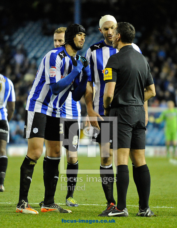 Picture by Richard Land/Focus Images Ltd +44 7713 507003.08/12/2012.Sheffield Wednesday players Miguel Llera & Martin Taylor confront Referee Andre Marriner following Gary Madine's disallowed goal during the npower Championship match at Hillsborough, Sheffield.