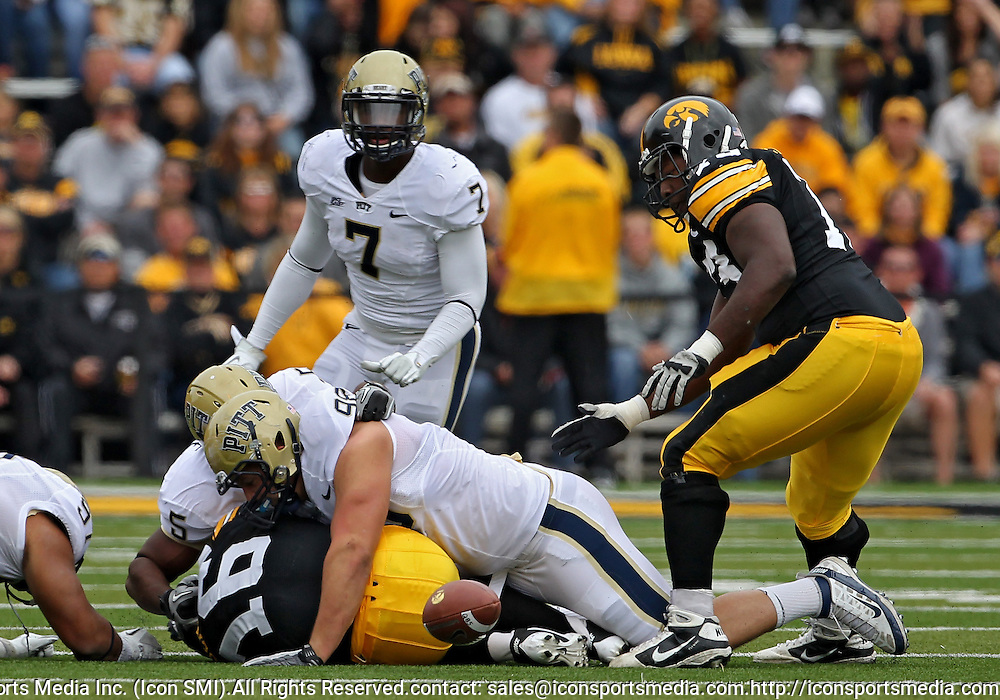 September 17, 2011: Iowa Hawkeyes quarterback James Vandenberg (16) fumbles the ball after being hit by Pittsburgh Panthers defensive tackle Chas Alecxih (98) during the first half of the game between the Iowa Hawkeyes and the Pittsburgh Panthers at Kinnick Stadium in Iowa City, Iowa on Saturday, September 17, 2011. Iowa defeated Pittsburgh 31-27.