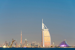Skyline at night of Dubai waterfront with Burj al Arab Hotel in United Arab Emirates