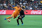 Houston Dynamo defender Jose Bizama (18) gets fouled by LAFC defender Eddie Segura (4) during a MLS soccer game, Saturday, Sept 25, 2019, in Los Angeles. LAFC wins 3-1. (Jon Endow/Image of Sport)