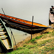 Typical emberá Indian boats sit by shore of the Chagres River.  The Emberás are one of the seven indigenous groups still present in Panama.  They are usually find by the Chagres River in the Panama Canal protected areas as well as in the mountains and rivers of the Darien jungle