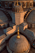 TURKEY, ISTANBUL, OTTOMAN CULTURE SULTAN AHMET CAMII; also called the BLUE MOSQUE; exterior view of dome and roof details