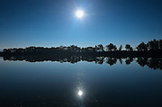 Reflection of sun in wetland<br /> Manville<br /> Alberta<br /> Canada