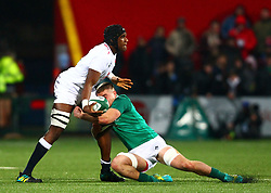 Joel Kpoku of England U20 offloads while being tackled by Scott Penny of Ireland U20 - Mandatory by-line: Ken Sutton/JMP - 01/02/2019 - RUGBY - Irish Independent Park - Cork, Cork - Ireland U20 v England U20 -