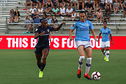 Manchester City forward Tessa Wullaert (25) dribbles the ball away from North Carolina Courage forward Crystal Dunn (19) during an International Champions Cup women's soccer game, Thurday, Aug. 15, 2019, in Cary, NC. The North Carolina Courage defeated Manchester City Women 2-1.  (Brian Villanueva/Image of Sport)