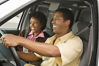 Couple Riding in Minivan