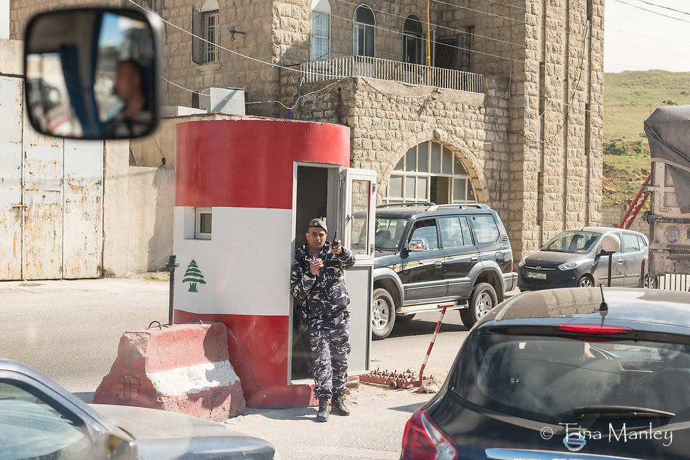 Armed guard at checkpoint going into Beirut, Lebanon, warns that photos are not allowed.