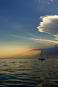 A Sailboat sailing on Saginaw Bay in the evening.